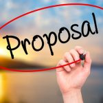 52532305 - man hand writing proposal with black marker on visual screen. isolated on background. business, technology, internet concept. stock photo